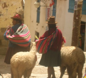 These two women and their alpaca pose for photos with passing tourists in the wealthy neighborhood of San Blas.