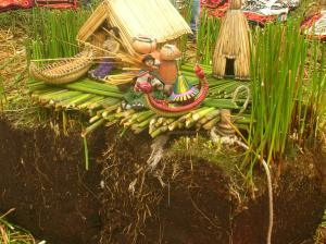 A model of one of the Uros floating islands as well as the reed boat on the far left.