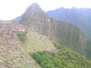 Machu Picchu ruins with Huayna Picchu behind.