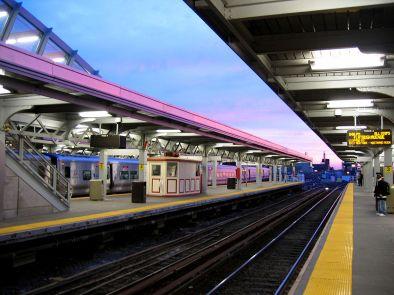 1200px-Jamaica_station_sunset,_waiting